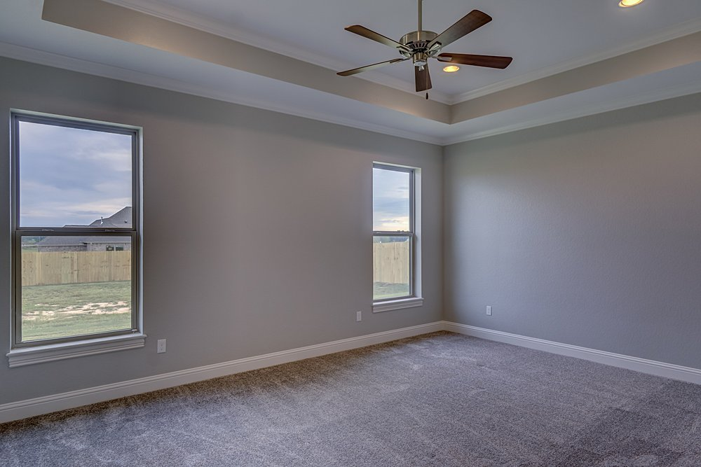 Master Bedroom Marketing Photography - 148 Bush Buck Way, Bullard, TX - Jayson Chandler Homes, Inc.